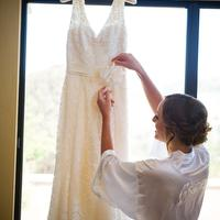 Scott Campbell photographed the bridesmaid adding the final details to the bride's dress on her wedding day at the Corral de Tierra Country Club.